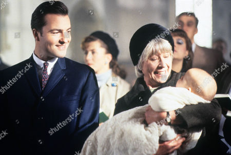 Episode 10 - It's All in the Game Picture shows - Nick Berry as PC Nick Rowan and Anne Stallybrass as Eileen Reynolds at the christening of Katie