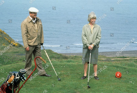 Episode 8 - Gone Tomorrow Picture shows - Derek Fowlds as Sergeant Oscar Blaketon and Anne Stallybrass as Eileen Reynolds have a game of golf