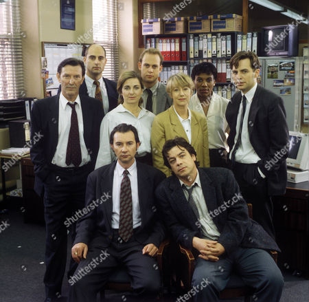 Back Row (L-R) Mark Strong as Insp Larry Hall, Andrew Woodhall as DI Brian Dalton, Karen Tomlin as WPC Norma Hastings, Philip Wright as DC Lillie, Middle Row (L-R) Tom Bell as Sgt Bill Otley, Liza Sadovy as WPC Katy Bibby, Helen Mirren as DCI Jane Tennison, Front Row (L-R) Mark Drewry as DI Ray Hebdon and Richard Hawley as DS Richard Haskons.