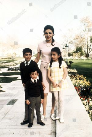 Stock Picture of Farah Diba Pahlavi with her children Prince Reza Pahlavi, Prince Farahnaz Pahlavi and Prince Ali-Reza Pahlavi