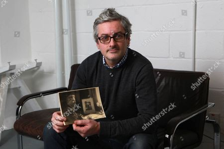Mark Logue with a photograph of his grandfather Lionel Logue who helped King George VI overcome his stammer as shown in film 'The King's Speech'