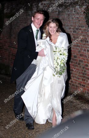 Stock Picture of Harry Aubrey-Fletcher and Sarah Louise Stourton leave the church