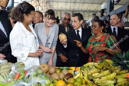 Marie-Luce Penchard, Carla Bruni-Sarkozy and Nicolas Sarkozy