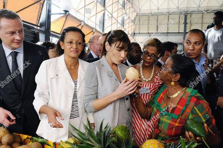 Bruno Le Maire, Marie-Luce Penchard and Carla Bruni-Sarkozy