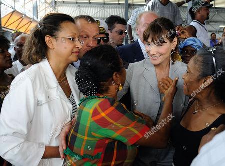 Marie-Luce Penchard and Carla Bruni-Sarkozy