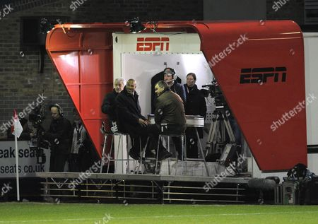 Ex Newcastle United manager Kevin Keegan, John Barnes and Ray Stubbs, watch the two teams warm-up from the mobile ESPN presentation trailer