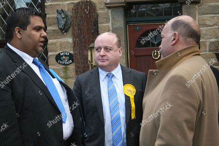 Conservative Candidate Kashif Ali (L) and Liberal Democrat Elwyn Watkins (C) interviewed by the BBC's John Pienaar