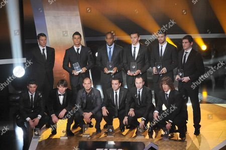 Stock Image of (From L-R and Up and Down) Marco van Basten, Real Madrid's Cristiano Ronaldo, Inter Milan's Maicon Douglas and Lucimar da Silva, Barcelona's Gerard Pique, Real Madrid's Iker Casillas, Barcelona's David Villa and Lionel Messi, Inter Milan's Wesley Sneijder and Barcelona's Xavi Hernandez, Andres Iniesta and Carles Puyol voted the best eleven players of 2010