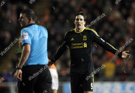 Stock Picture of Fernando Torres of Liverpool reacts after been booked by referee Mr Micheal Oliver