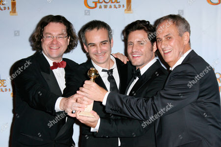 Stock Picture of Best mini-Series or Motion Picture Made for Television for 'Carlos' producer Jens Meurer, writer/director Olivier Assayas, Edgar Ramirez and producer Daniel Leconte.
