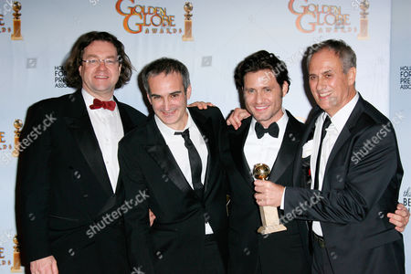 Stock Photo of Best mini-Series or Motion Picture Made for Television for 'Carlos' producer Jens Meurer, writer/director Olivier Assayas, Edgar Ramirez and producer Daniel Leconte.