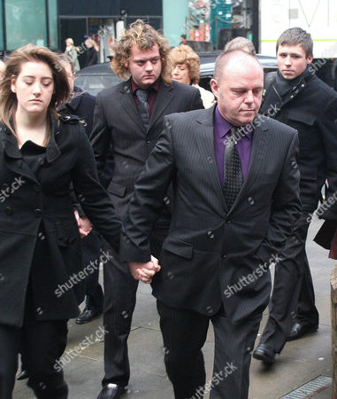 Student Edward Woollard with his family, stepfather Michael is in the foreground