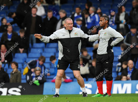 Blackburn Assistant Manager John Jensen with a Blackburn player
