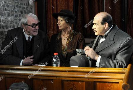 Eric Sykes as Fullerton and David Suchet as Hercule Poirot.