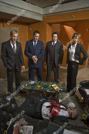 Stock Photo of Shaun Dingwall as DCI Mike Lewis, Ciaran Hinds as DCS James Langton, Celyn Jones as DS Paul Barolli and Kelly Reilly as DI Anna Travis with Callum Sutherland as the dead Frank Brandon