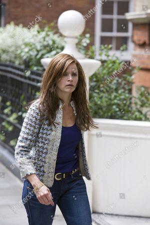 Stine Stengade as Julia Larson.