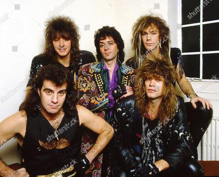 Bon Jovi backstage at the Norwich Playhouse - clockwise from bottom left - Tico Torres, Richie Sambora, Alec John Such, David Bryan and Jon Bon Jovi