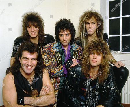 Stock Photo of Bon Jovi backstage at the Norwich Playhouse - clockwise from bottom left - Tico Torres, Richie Sambora, Alec John Such, David Bryan and Jon Bon Jovi