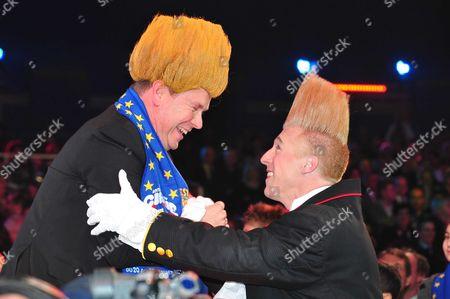 Prince Albert II of Monaco (lt) wears for fun, the same wig as the American clown Bello Nock (rt) winner of the 2011 Golden clown
