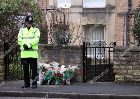 A policeman outside the home of Joanna Yeates