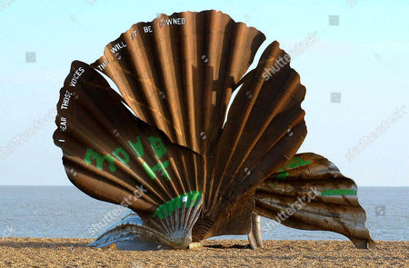 The vandalised sculpture - 'The Scallop' by Maggie Hambling - in November 2004. Aldeburgh beach, Suffolk, England, Britain.