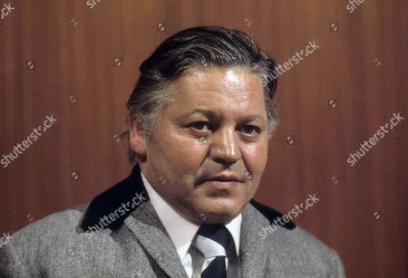 Stock Photo of Wolfe Morris as Muhammed Aslam
