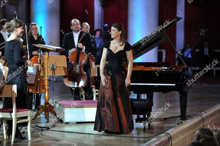 Stock Image of Polina Osetinskaya and the International Symphony Orchestra of Germany
