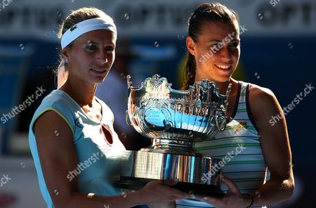 Gisela Dulko of Argentina and Flavia Pannetta of Italy celebrate with the trophy following their win