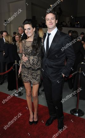 Armand Hammer (R) and Elizabeth Chambers (L)