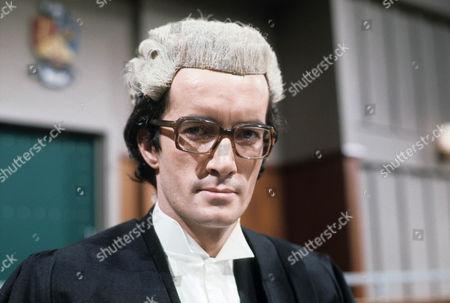 Clive Merrison as Charles Banham QC