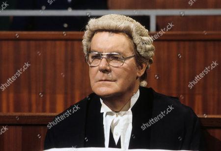Thorley Walters as George Unwin QC