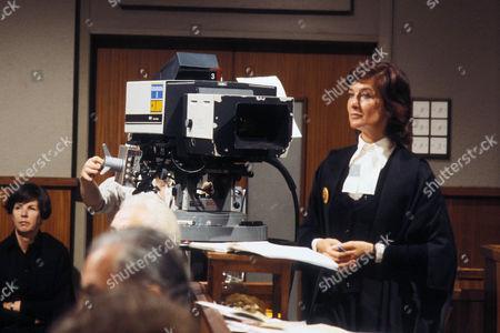 Behind the scenes filming camera on set and Caroline Blakiston as Kathleen Fenton QC