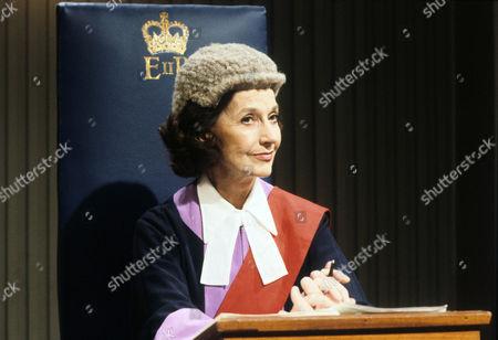 Judy Campbell as Judge Crawford