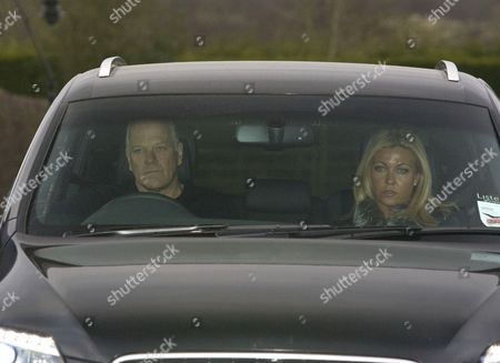 Stock Photo of Andy Gray and girlfriend Rachel Lewis leaving his home