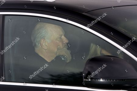 Andy Gray leaving his home