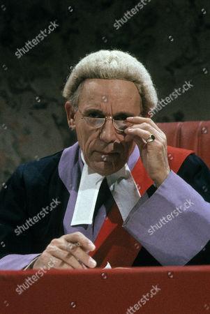 John Woodnutt as Justice Weightman