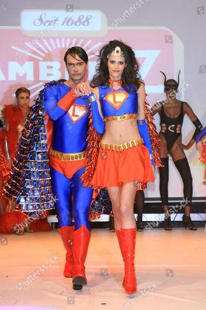 Markus Schenkenberg and Alisar Ailabouni as Supergirl