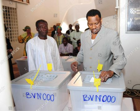 Stock Picture of Niger's presidential candidate Hama Amadou casts his ballot at a polling station