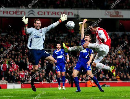 Goalkeeper Marton Fulop of Ipswich Town blocks Robin van Persie of Arsenal's shot