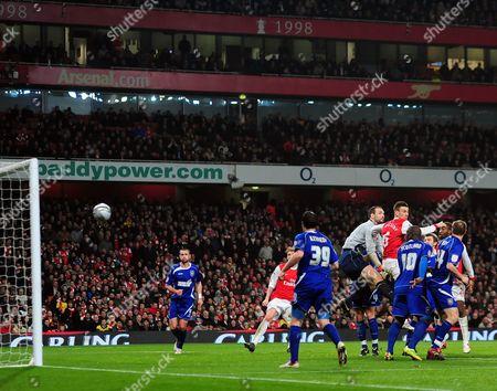Laurent Koscielny of Arsenal scores past Goalkeeper Marton Fulop of Ipswich Town