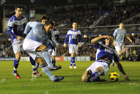 Carlos Tevez of Manchester City scores the opening goal of the game past a diving Martin Jiranek of Birmingham City, 0-1