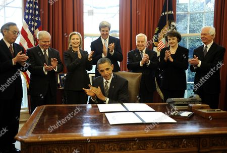 United States President Barack Obama signs the New START Treaty with U.S. Secretary of Energy Steven Chu, U.S. Secretary of Defense Robert Gates, U.S. Secretary of State Hillary Clinton, U.S. Senator John Kerry (Democrat of Massachusetts), U.S. Senator Richard Lugar (Republican of Indiana), U.S. Senator Dianne Feinstein (Democrat of California) and U.S. Senator Thad Cochran (Republican of Mississippi)