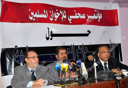 Stock Picture of Egyptian Muslim brotherhood seniors Essam Erian, Mohamed Morsi and Saad el-Katatni during a press conference
