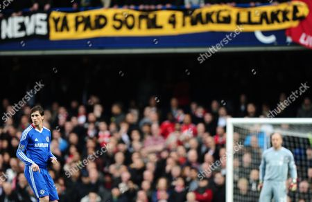 Fernando Torres of Chelsea beneath a banner reading 'Ya Paid 50mil 4 Margi Clarke'