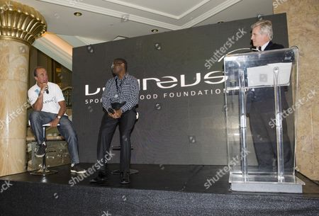 Stock Image of Hugo Porta with Moses Mutuli, graduate of the Laureus Mathatre Youth Sports Association in Nairobi and Steve Ryder, far right