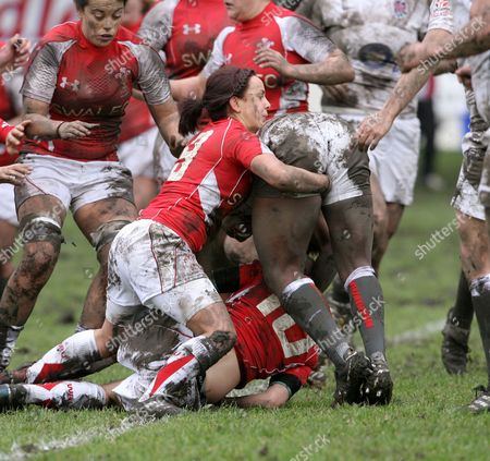 Welsh number 9 Amy Day feels for the ball as she tackles Margaret Alphonsi of England