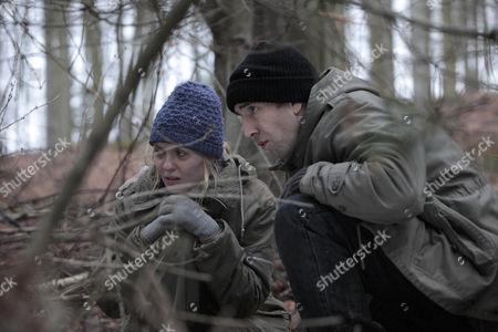 Sam Dingle [James Hooton] and Olena Petrovich [Carolin Stoltz] run for it as Lisa Dingle knocks the police to the ground.