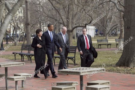 United States President Barack Obama walks across Lafayette Park with William Daley, White House chief of staff, second from right, Gene B Sperling, director of the National Economic Council, right, and Valerie Jarrett, senior adviser, on the way to the U.S. Chamber of Commerce