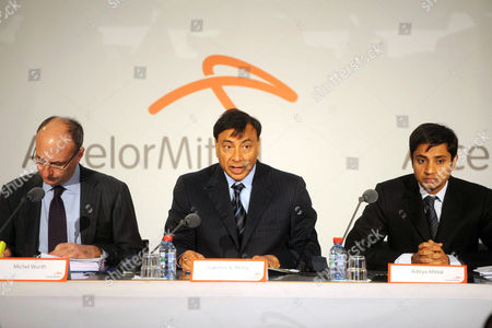 Michel Wurth Member of the Group Management Board, chairman of the board of directors and chief executive officer of the world's largest steel company, ArcelorMittal, Lakshmi Mittal (C), with his son Aditya Mittal (R), chief financial officer and member of the group management board