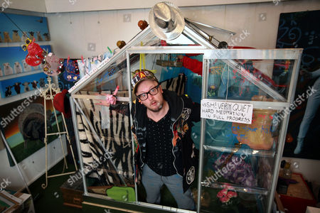 Stock Image of Matt Whistler inside the greenhouse at the Julie-Anne Gilburt art gallery that he will be living in for 30 days